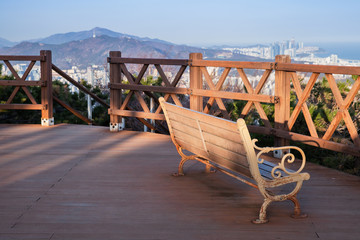 Wooden bench in mountain park of Busan