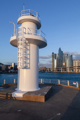 White lighthouse in fishing port of Busan
