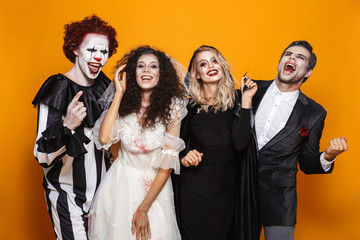 Group of laughing friends dressed in scary costumes Fototapete