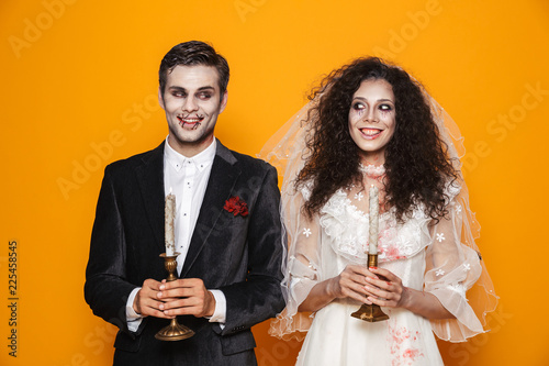 Happy couple dressed in scary Haloween costumes