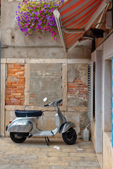 Chioggia, Italy-August 26, 2018: Province of Venice. moped parked on a city street.