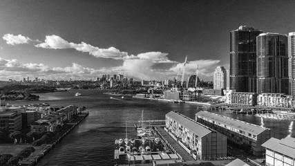 SYDNEY, AUSTRALIA - AUGUST 19, 2018: City skyline aerial view from Darling Harbour. Sydney attracts 15 million tourists annually