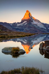 Matterhorn, Swiss Alps. Landscape image of Swiss Alps with Stellisee and Matterhorn in the background during sunrise.
