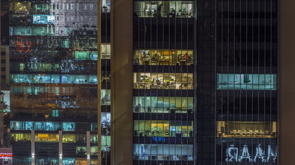 Scenic glowing windows of skyscrapers at evening timelapse