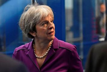 Britain's Prime Minister Theresa May arrives at the ICC for the third day of the Conservative Party Conference in Birmingham