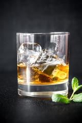 Foto op Plexiglas Bar Glass of rum on the dark background