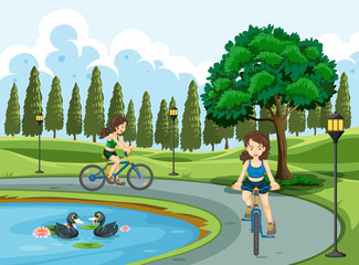 Young girls riding bicycle