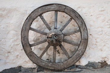 old wooden wheel - antique horse carriage wheel