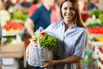 Portrait of beautiful woman holding shopping basket