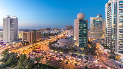 Dubai Creek area surrounded by modern buildings and busy traffic street day to night timelapse