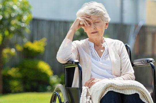 Depressed old woman in wheelchair