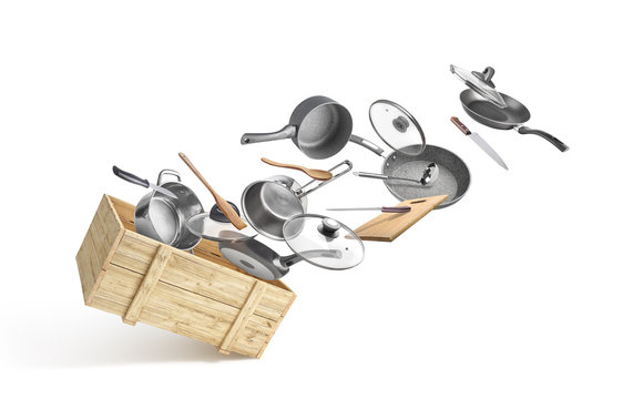 Wooden box with flying utensils isolated on white background