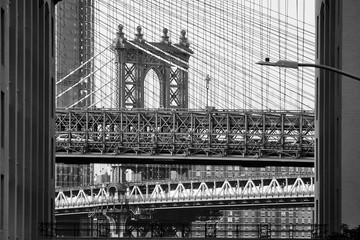 Black and white picture of Brooklyn and Manhattan Bridge in one frame, New York City, USA