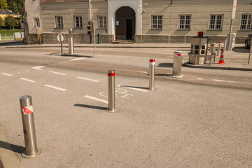 Automatic retractable bollards limiting traffic on the road in the old town of Salzburg, Austria