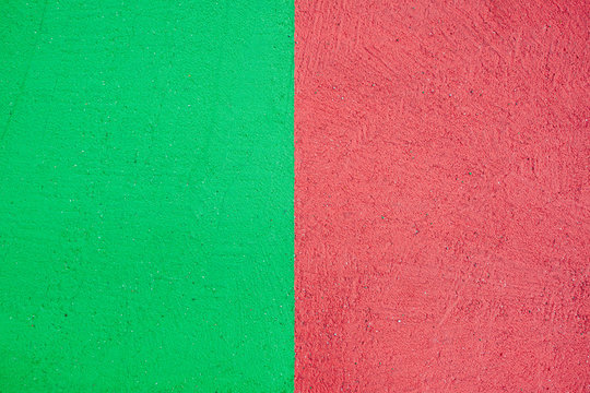 Red and green colored asphalt on street, texture background