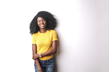 Portrait of smiling young woman in yellow tshirt