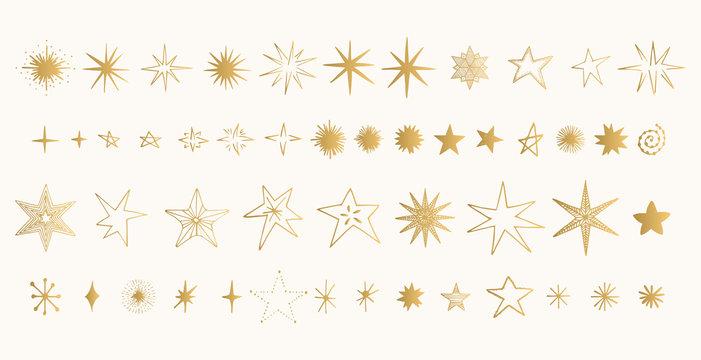 Set of golden stars. Glitter shapes. Vector.