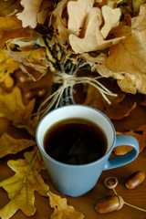 bouquet of oak leaves and a cup of tea