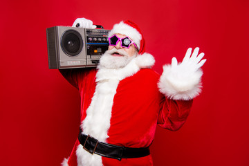 Carefree aged mature stylish Santa with white beard in costume s