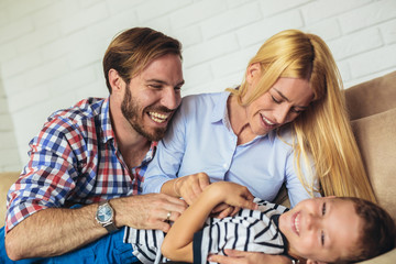 Family spending time at home with their son and having fun.
