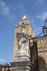 Cefalu, Italy - September 09, 2018: Statue at the entrance gate of the Cathedral of Cefalu