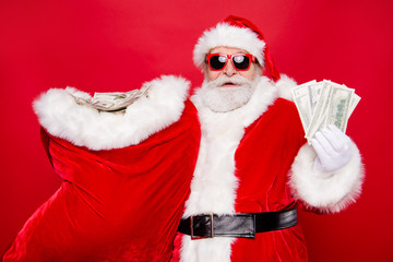 Portrait of Santa in eyeglasses gloves outfit holding carrying h