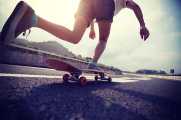 Skateboarder skateboarding on highway road