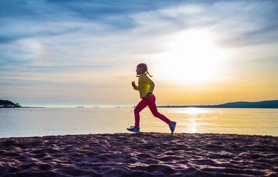 girl running along  sea beach