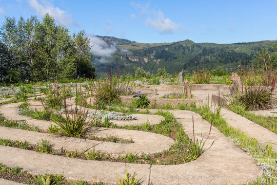 Maze concrete pathway of a labyrinth on the edge of misty valley in Hogsback, South Africa