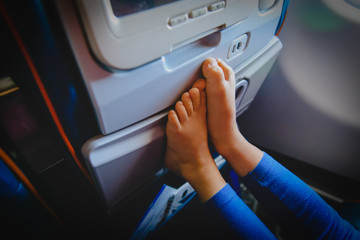 little girl travel by plane, child in flight, safety concept
