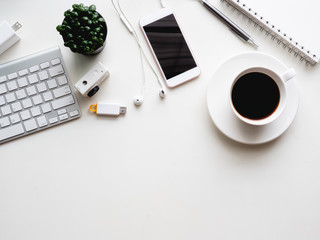 top view of office desk workspace with notebook, smartphone and gadget on white background with copy space, graphic designer, Creative Designer concept.