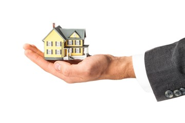 Men's Hand Holding a Model of a House