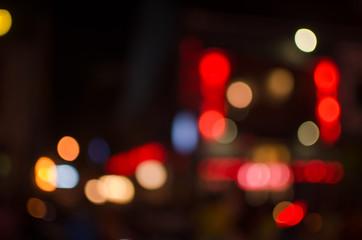 Abstract city night defocused light, blur bokeh, colorful & dark background. Street, shiny, backdrop & pattern.