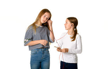 Young teen girls on white background listening to music
