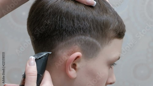 A Modern Teenage Hairstyle In A Barber Shop A Close Up Of The Hands