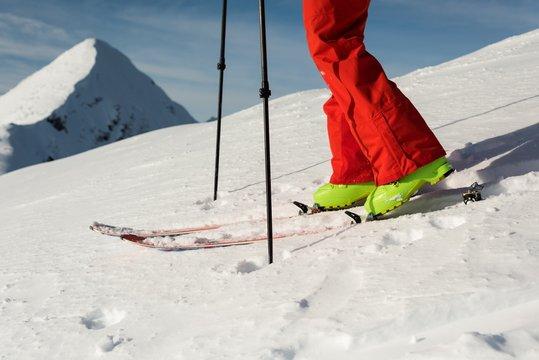 Male skier walking with ski board on a  snowy mountain