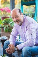 Mature man smiling at home