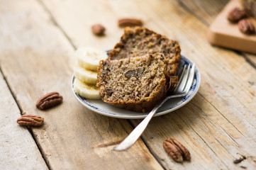 Slice of homemade banana bread on a white plate