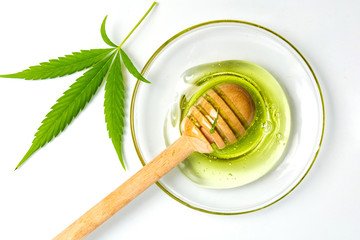 Cannabis honey and a dipper spoon isolated