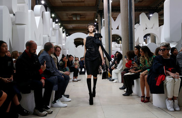 A model presents a creation  by Italian designer Miuccia Prada as part of her Spring/Summer 2019 women's ready-to-wear collection show for fashion house Miu Miu during Paris Fashion Week