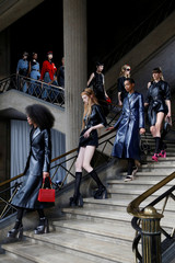 Models present creations by Italian designer Miuccia Prada as part of her Spring/Summer 2019 women's ready-to-wear collection show for fashion house Miu Miu during Paris Fashion Week