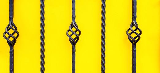 wrought iron fence on yellow background Fototapete