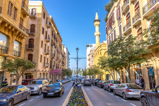 Beirut, Lebanon - Feb 5th 2018 - Amazing very modern area in Beirut downtown, cars, flowers, mosque in the background, french design in Beirut, Lebanon