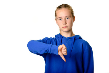 Young teen girl on white background showing thumbs down