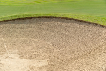 Beautiful Bunkers sand and green grass in golf court.