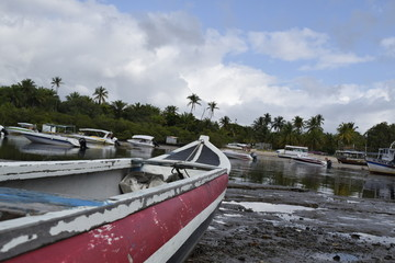 canoe and fishing boat, island of Boipeba, Cairu, Bahia, Brazil