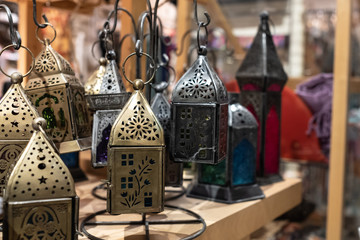 lanterns from india in an antique shop