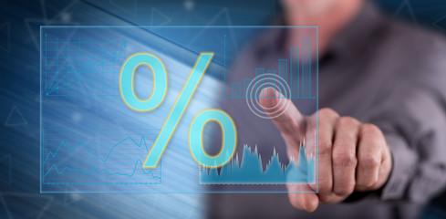 Man touching digital interest rates data