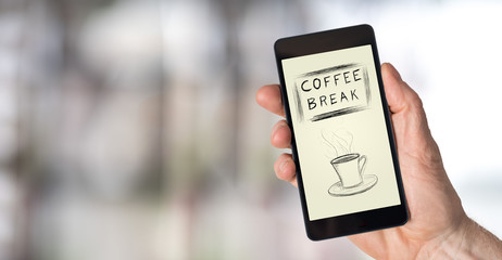 Coffee break concept on a smartphone