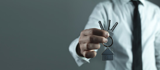 Real estate agent giving house key. Real estate concept